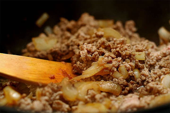 Browned ground beef with onions and garlic in a pan