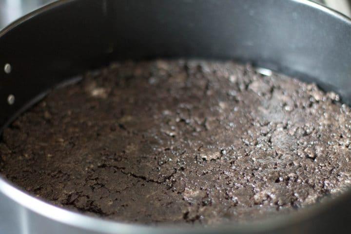 Chocolate Oreo crust in a springform pan