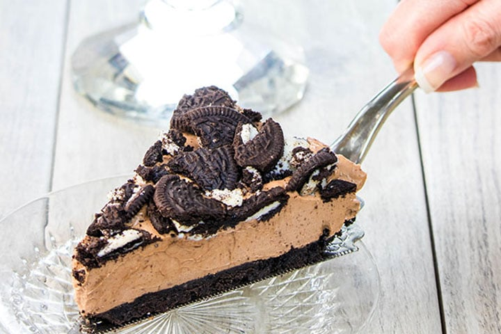 A slice of no bake Oreo cheesecake being served