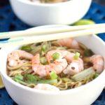 A bowl of Chinese shrimp noodle soup with chopsticks