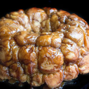 A close up of monkey bread with caramel drizzle