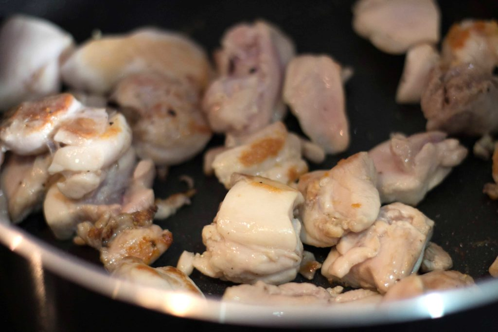 chicken in a pan being browned