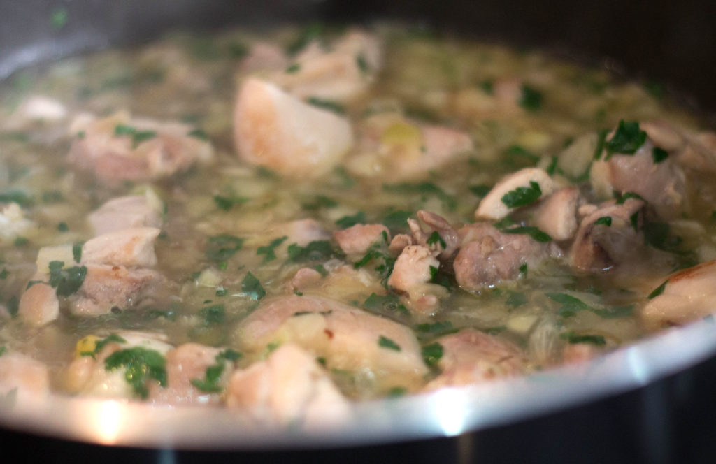 stock added to the pan of chicken
