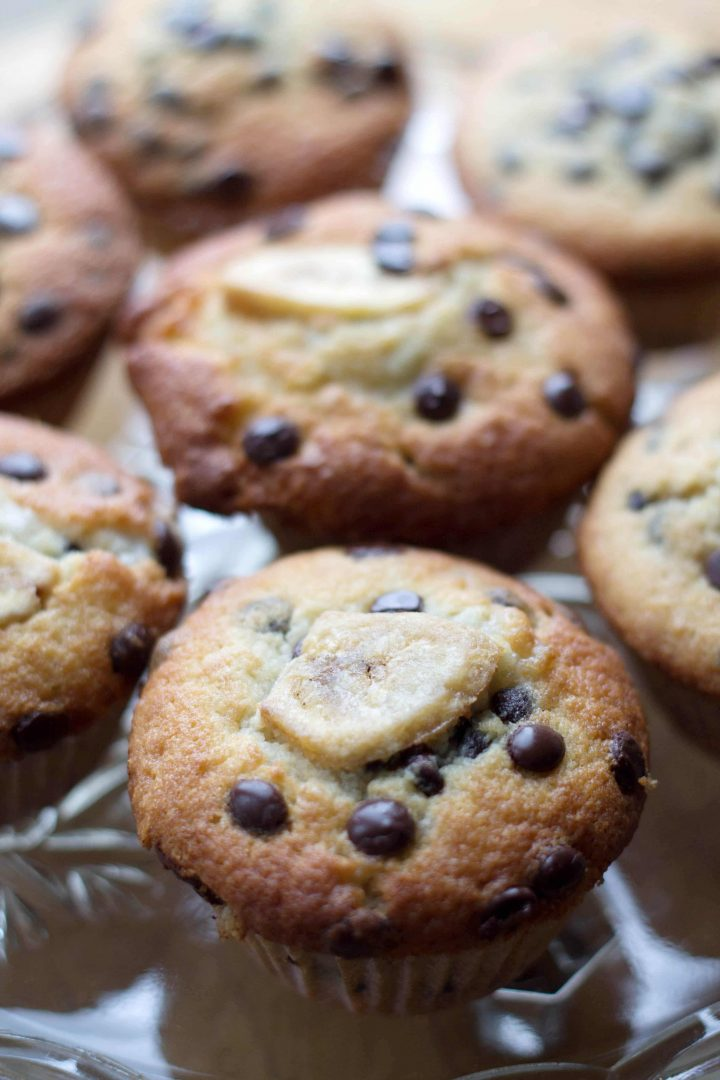 Chocolate Chip Banana Muffins lines up on a serving tray.