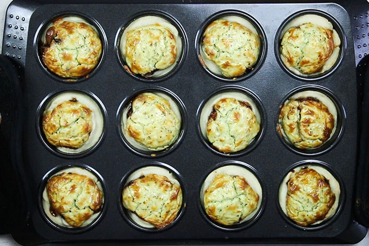 The baked Feta and Caramelized Onion Tarts still in the pan