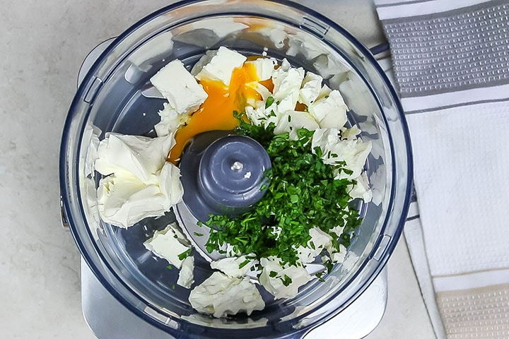 The feta, egg, cream cheese and parsley in a food processsor