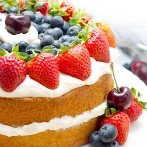 Vanilla Cream Sponge Cake topped with whipped cream and fresh berries
