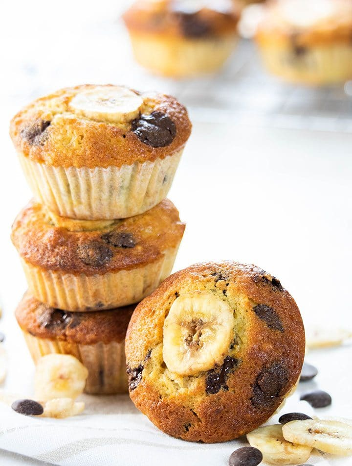 Banana Chocolate Chip Muffins stacked on top of each other with one facing forward