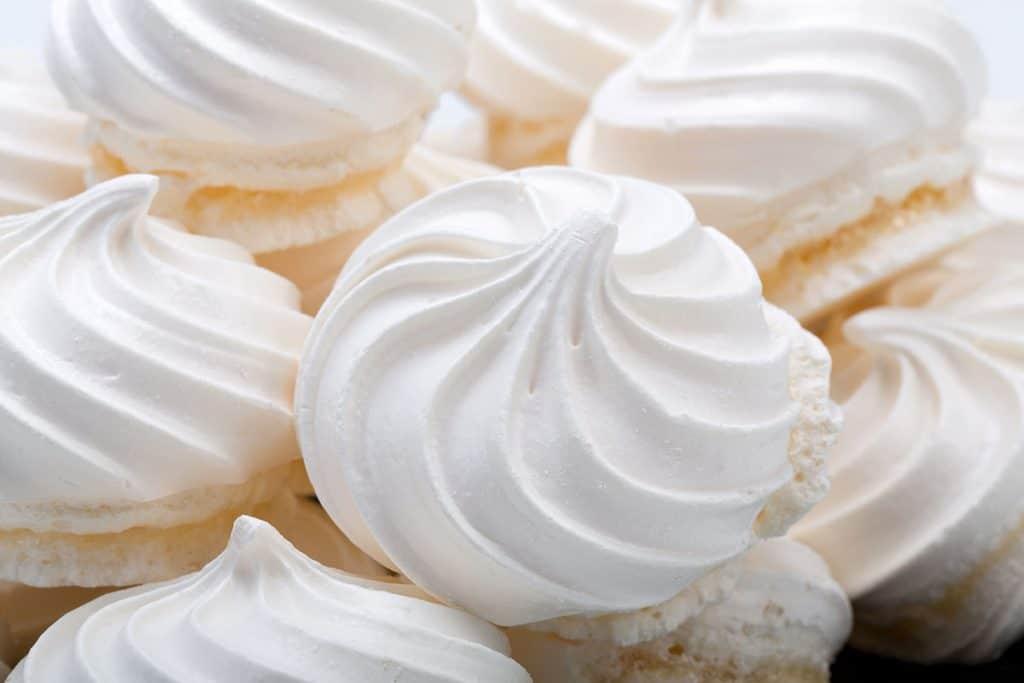 a big pile of meringue cookies