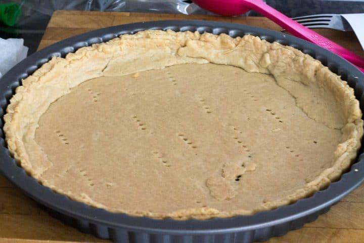 golden pie crust baked in the pan