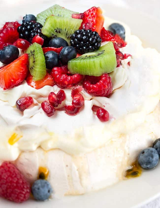 Pavlova with strawberries, blueberries, raspberries and passionfruit