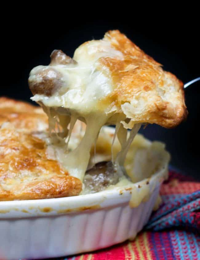 a peice of Cheesy Chicken & Mushroom Pie being served