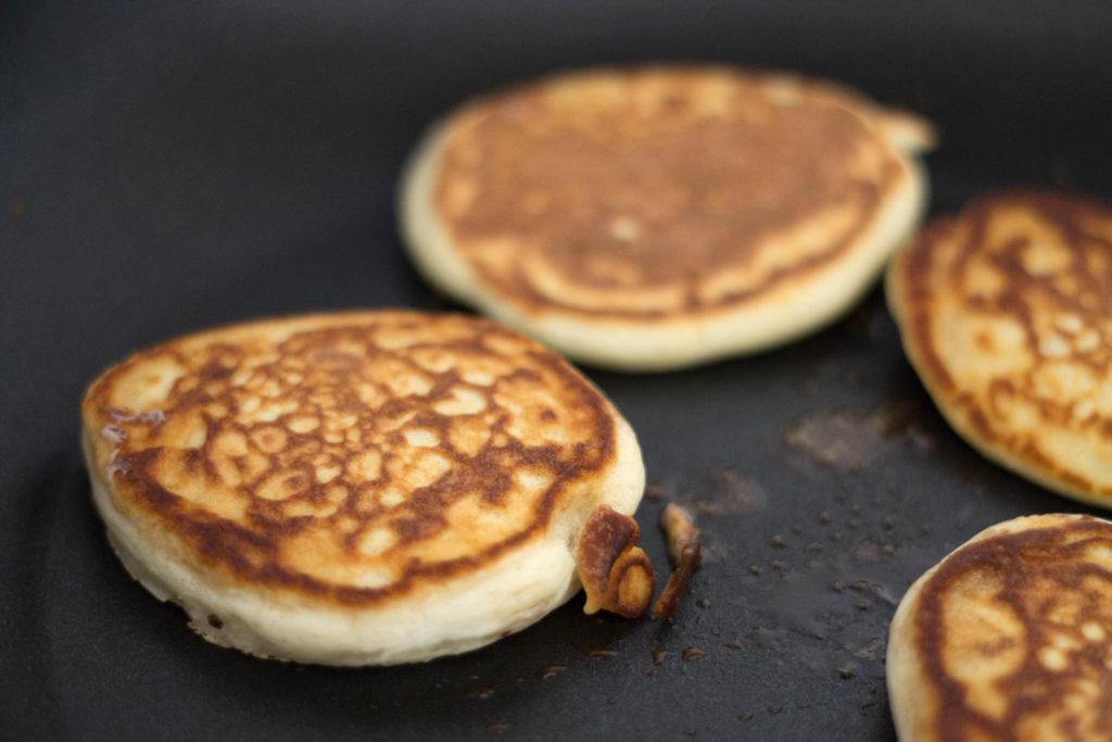 pancakes cooking in a pan