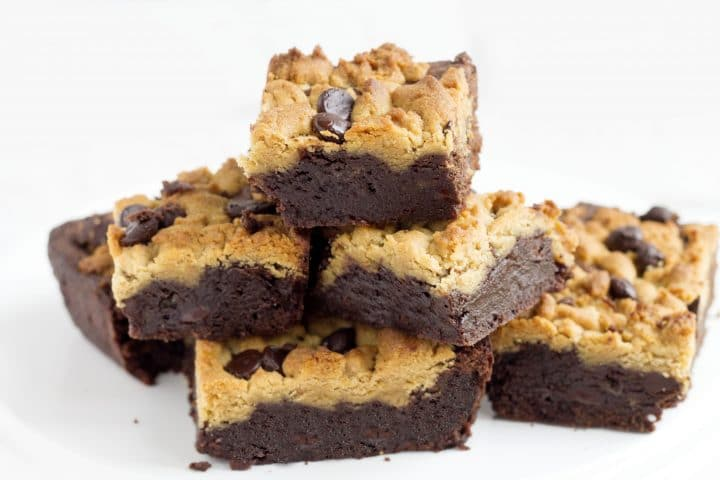 squares of peanut butter chocolate fudge brownies piled on top of each other