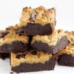 peanut butter chocolate fudge brownies piled on top of each other