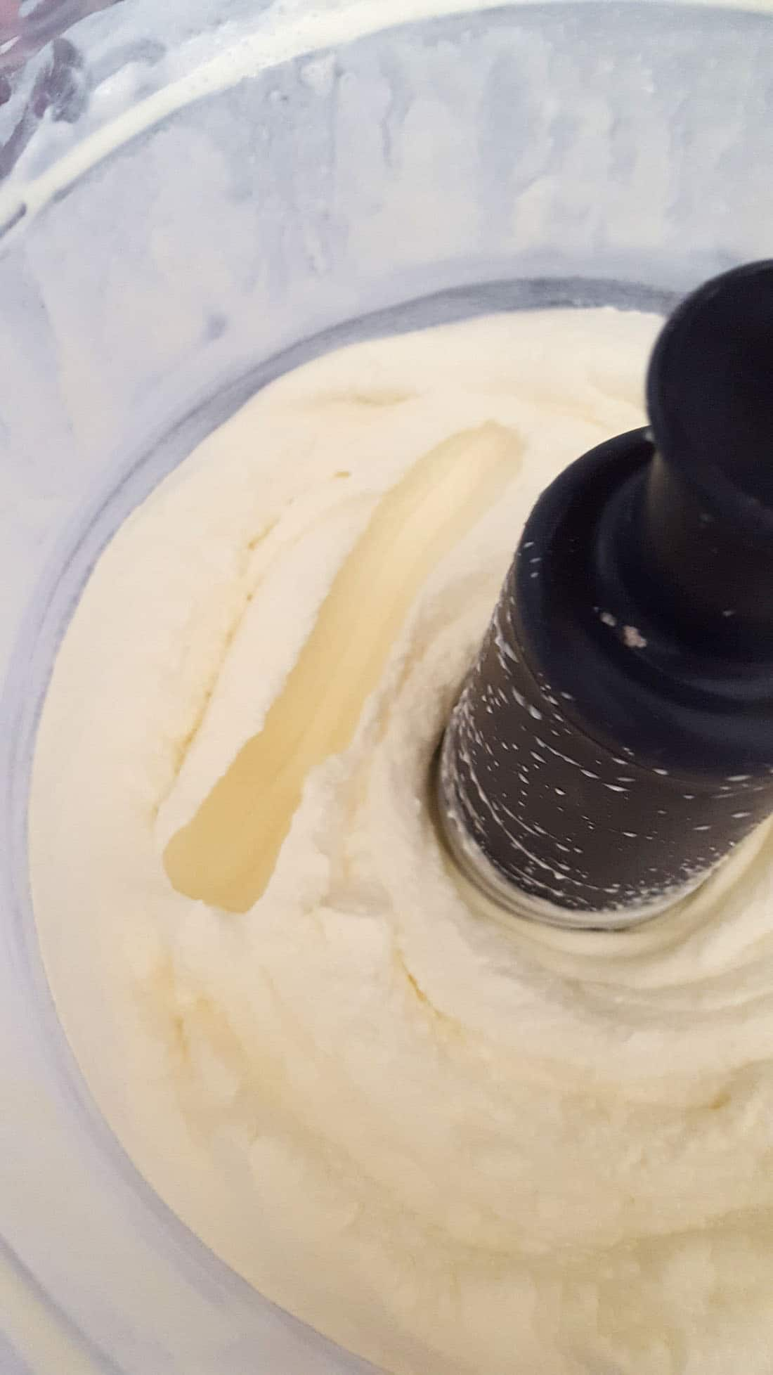 Whopped cream with a well made by running a knife through it.