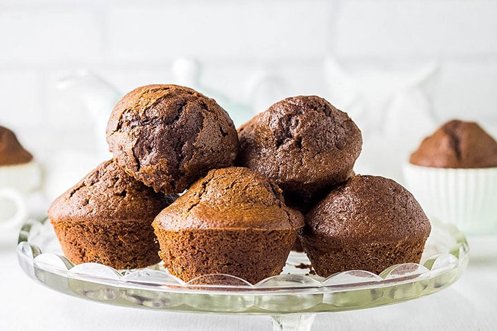 Double Chocolate Chip Muffins piled high on a serving dish