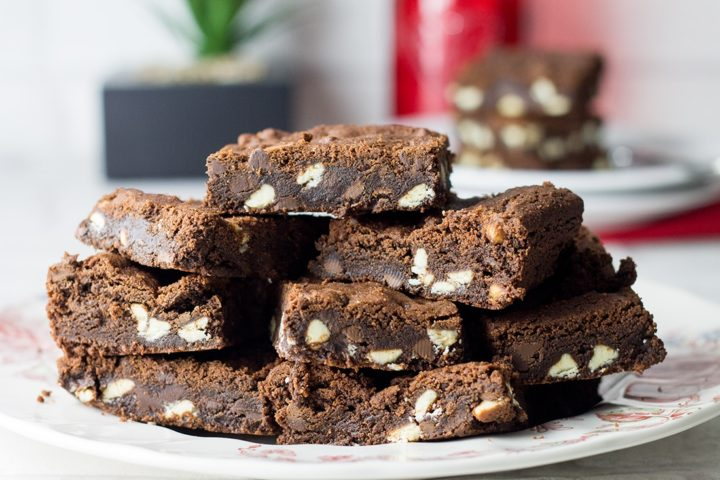 A plate piled with gorgeous triple choc cookie bars.
