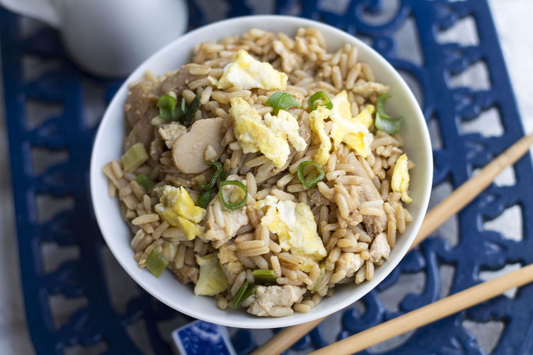 A bow of low fat chicken fried rice with chop sticks next to it