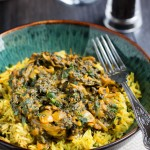 Quick & Easy Sag Bahji {Spinach Curry} served in a bowl over yellow rice