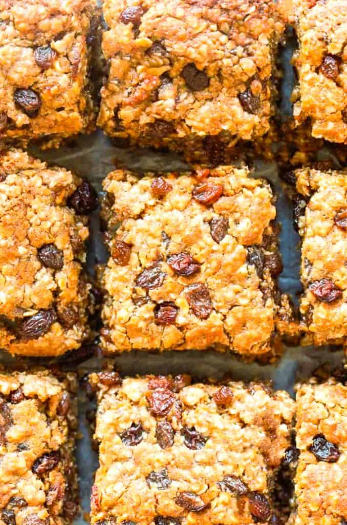 fresh baked Oatmeal Raisin Cookie Bars on a cooling rack