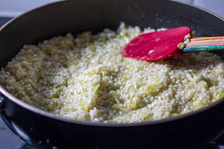 The wine absorbed into the rice in the pan
