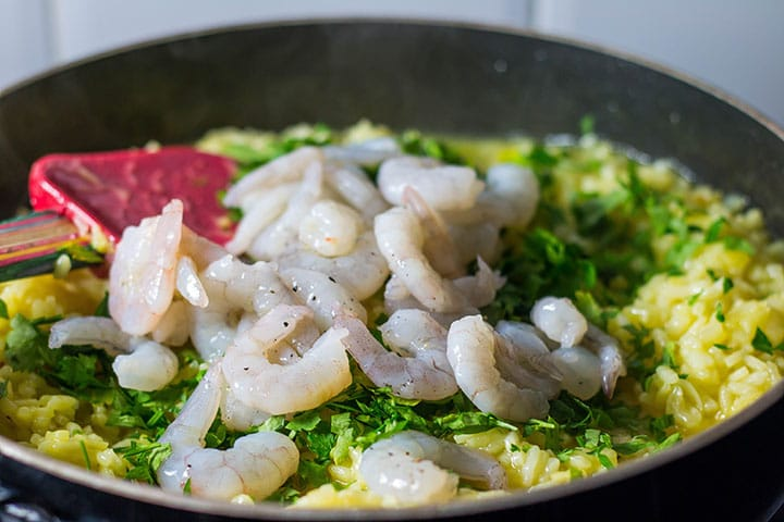 The shrimp added to the saffron risotto.