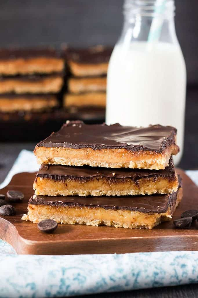 three Toffee pars stacked on top of eachother with a little bottle of milk in the background
