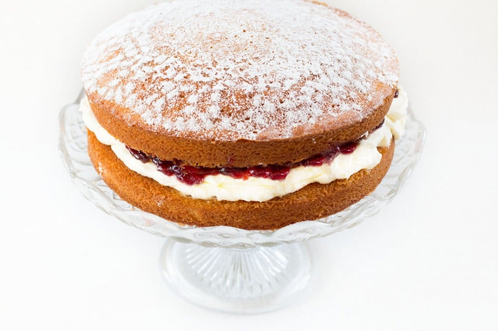 Classic Victoria Sponge Cake - Erren's Kitchen - This recipe uses the classic ingredients of vanilla sponge cake, fresh whipped cream and raspberry jam. Whether you're serving it for a special occasion or just to satisfy a craving, You can't go wrong with this perfect cake.