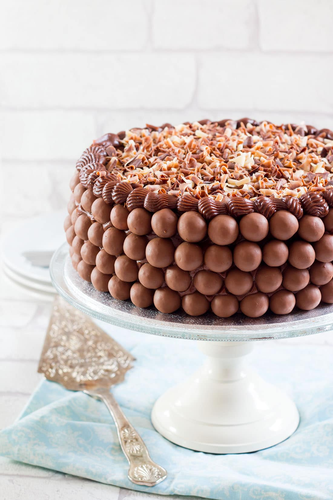 Chocolate Lovers Dream Cake - Erren's Kitchen - Indulge yourself with this amazing recipe. This heavenly moist, fudgy chocolate cake is filled with dark chocolate pudding, covered with chocolate butter cream, a layer of malted milk chocolate balls and topped with a layer of chocolate curls. Its any chocolate lover's dream cake.