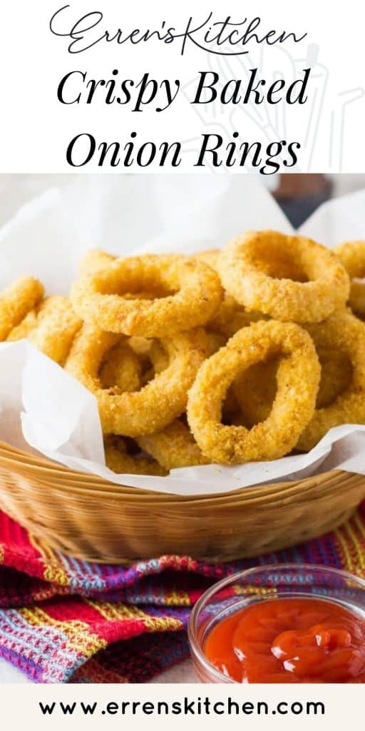 onion rings in a basket with a side of tomato sauce