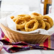 This recipe for Skinny Seasoned Baked Onion Rings from Erren's Kitchen makes a simple side dish of homemade and low fat onion rings that's so much healthier than fried - this version has a spiced breadcrumb coating that will make it a new family favorite.