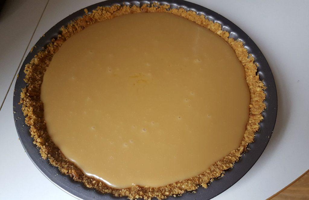 caramel poured over the graham cracker base