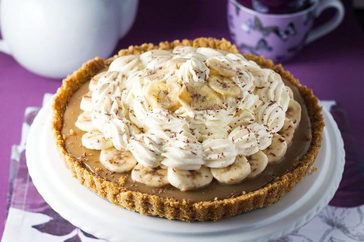 The Banoffee Pie On A Cake Stand Showing Crust Caramel Layer Banana