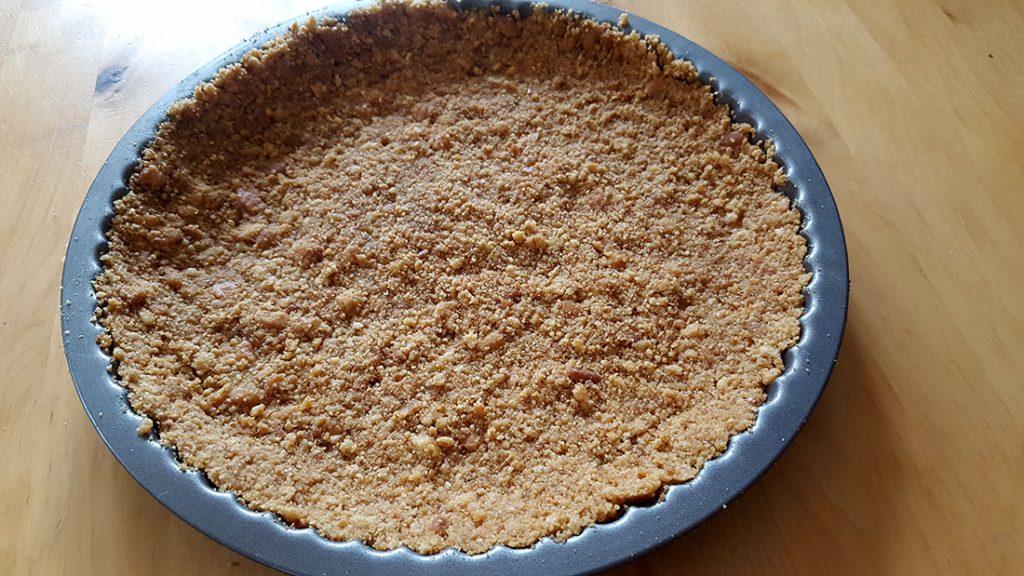 graham cracker base in a pie pan