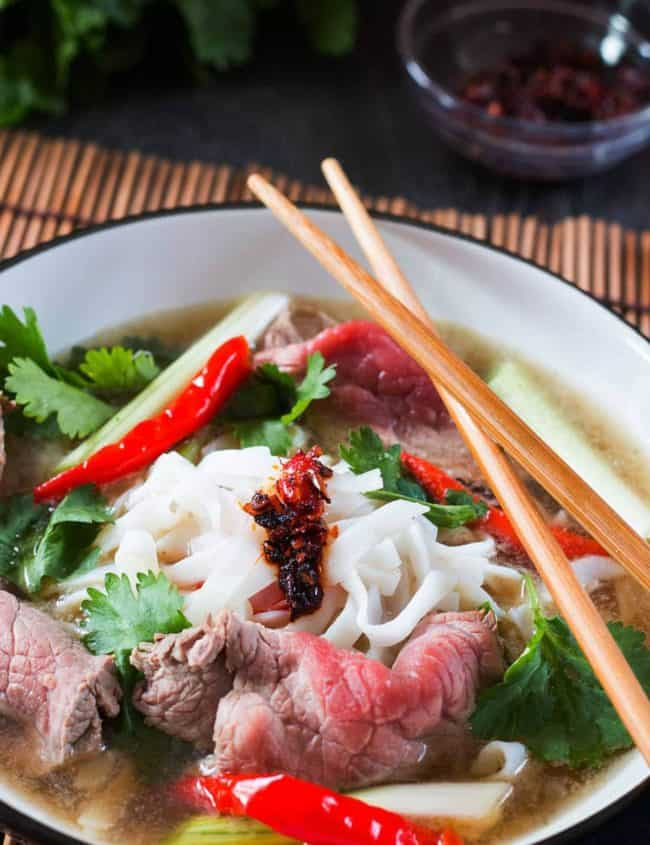 Vietnamese Beef Noodle Pho in a bowl with chopsticks