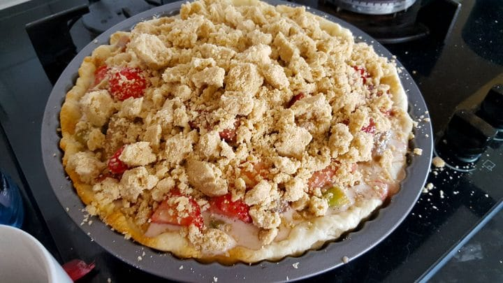Rhubarb and Strawberry Crumb Pie filled and topped with the crumb topping ready to bake