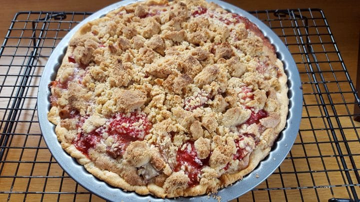 Rhubarb and Strawberry Crumb Pie fresh out of the oven on a cooling rack