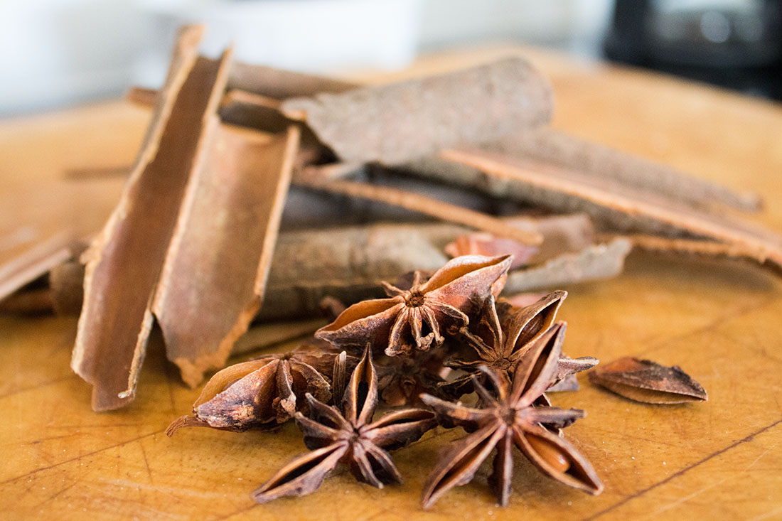 cinnamon sticks and star anise on a wooden board