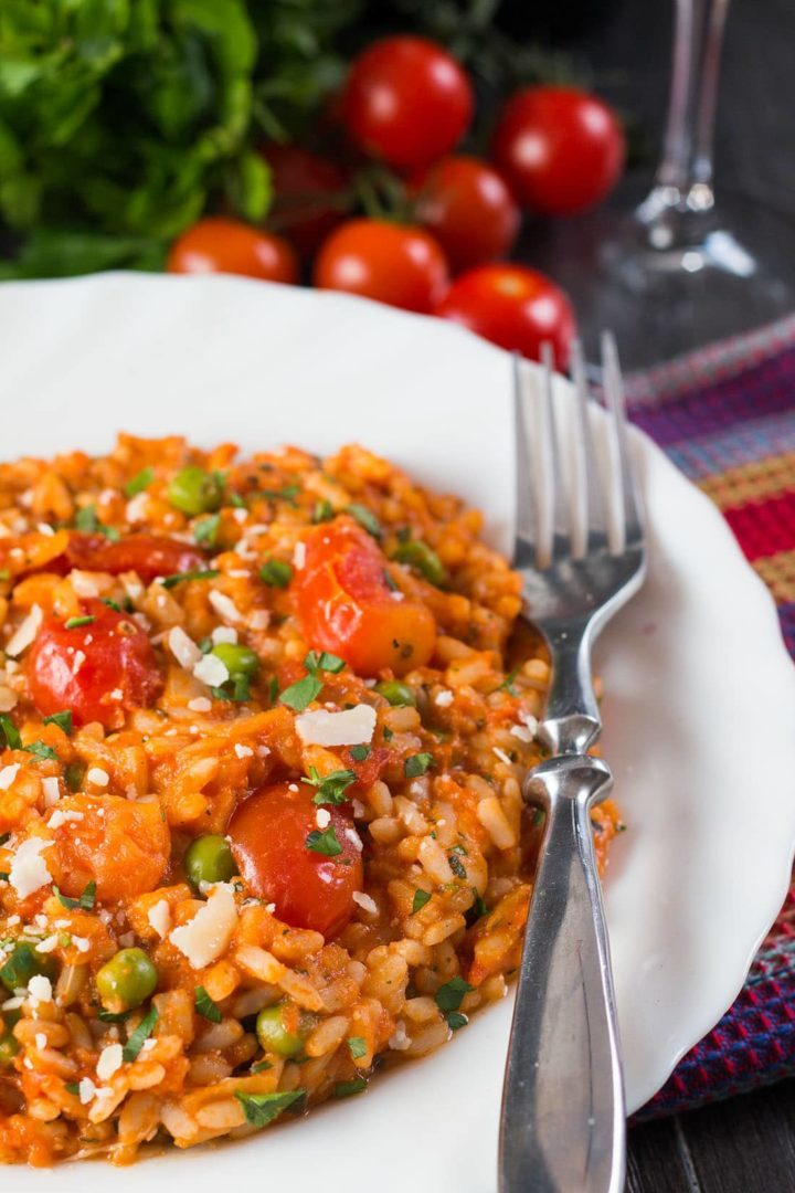 Roast Tomato and Pea Risotto in a dish with a fork