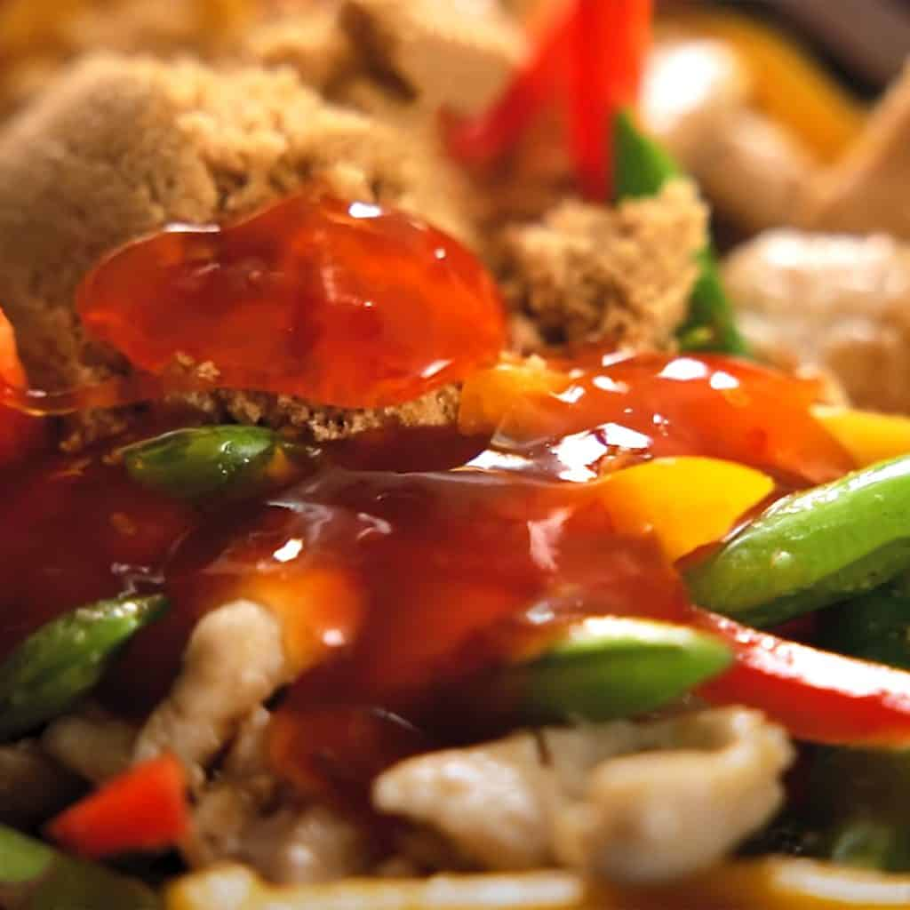 sweet chili sauce added to the chicken mixture in the pan
