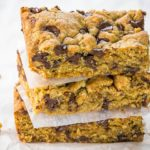 Three Chocolate Chip Oatmeal Cookie Bars stacked on top of each other.