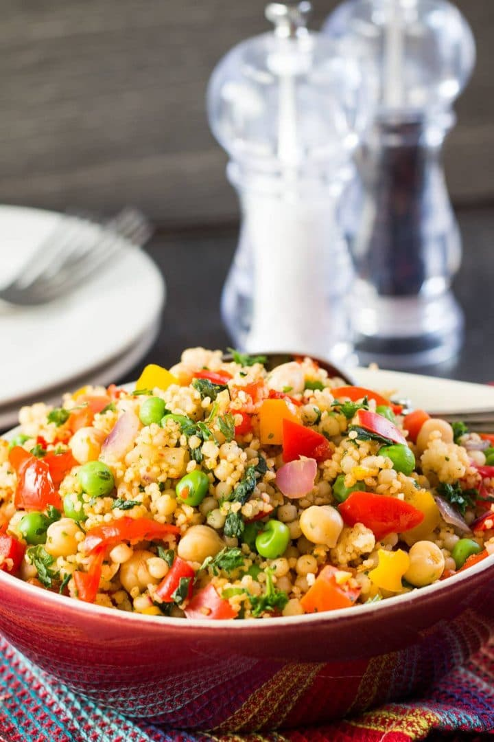 Moroccan Spiced Vegetable Couscous with colorful mixed vegetables, chickpeas, and differently sized couscous.