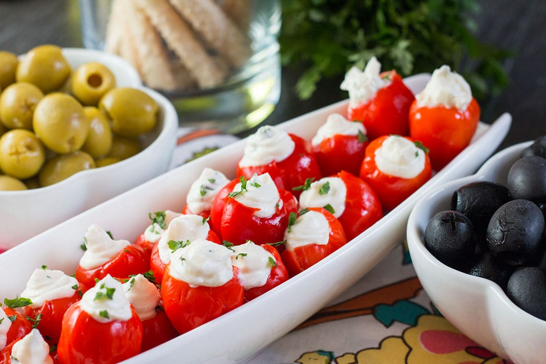 This recipe from Erren's Kitchen for Garlic & Herb Cream Cheese Stuffed Peppadews makes a flavorful starter that is perfect as a part of a antipasti platter or or Holiday or Dinner Party spread .