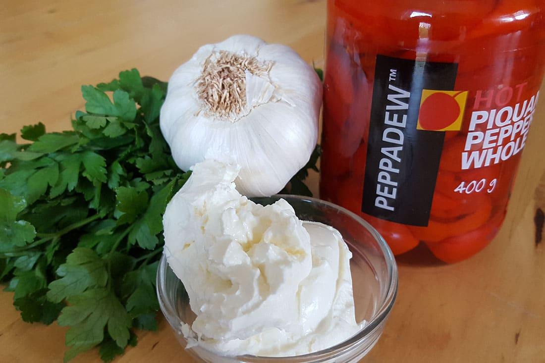 Cream cheese garlic parsley next to a jar of Peppadew Peppers