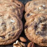 This recipe for Nutty Chocolate Chip Cookies has peanut butter, hazelnut spread, and three types nuts added to the dough to make one fantastic cookie!