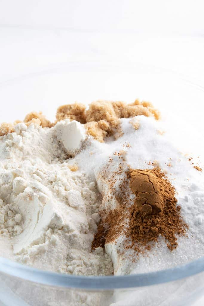 The dry ingredients in a glass mixing bowl