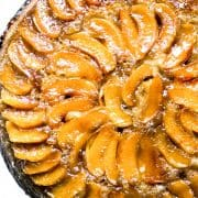 A close up of a warm apple cake topped with baked apples