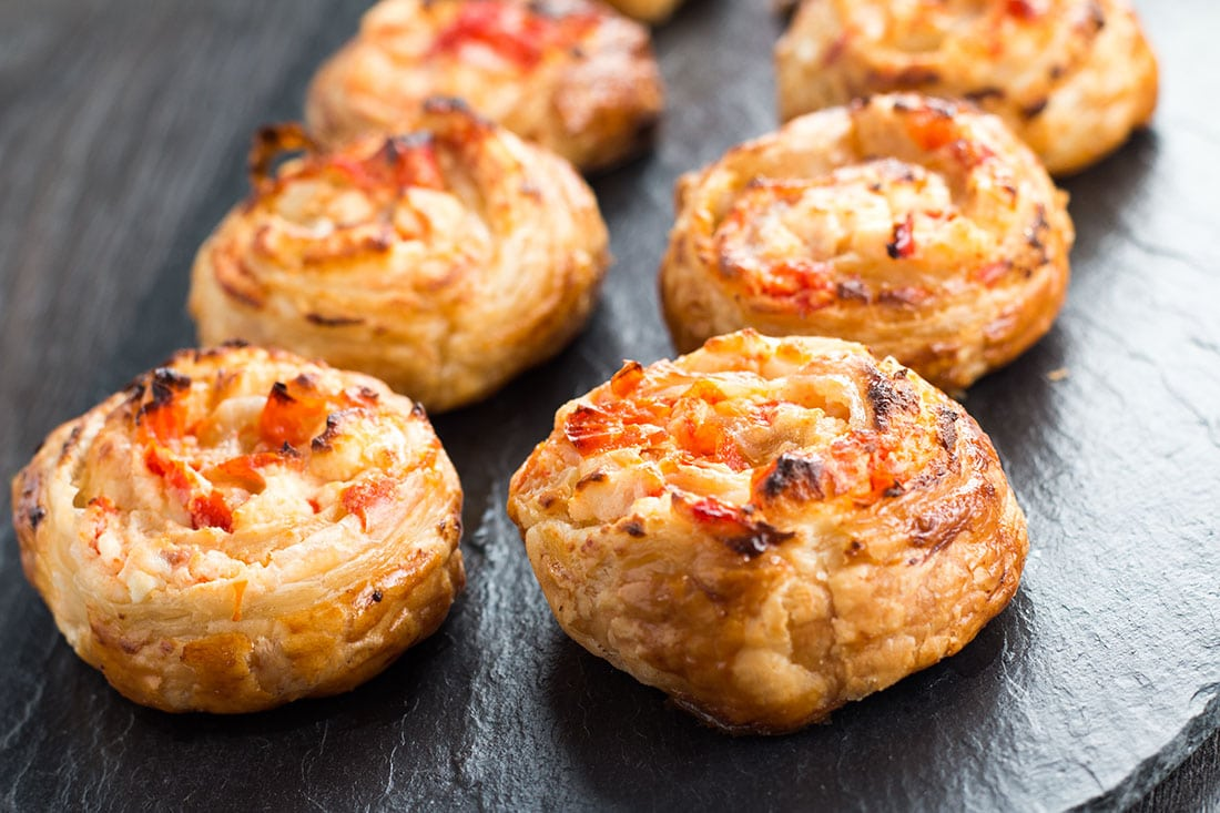This simple recipe for Feta & Sweet Pepper Pastry Swirls is perfect for the holidays, dinner parties or just as an everyday snack.