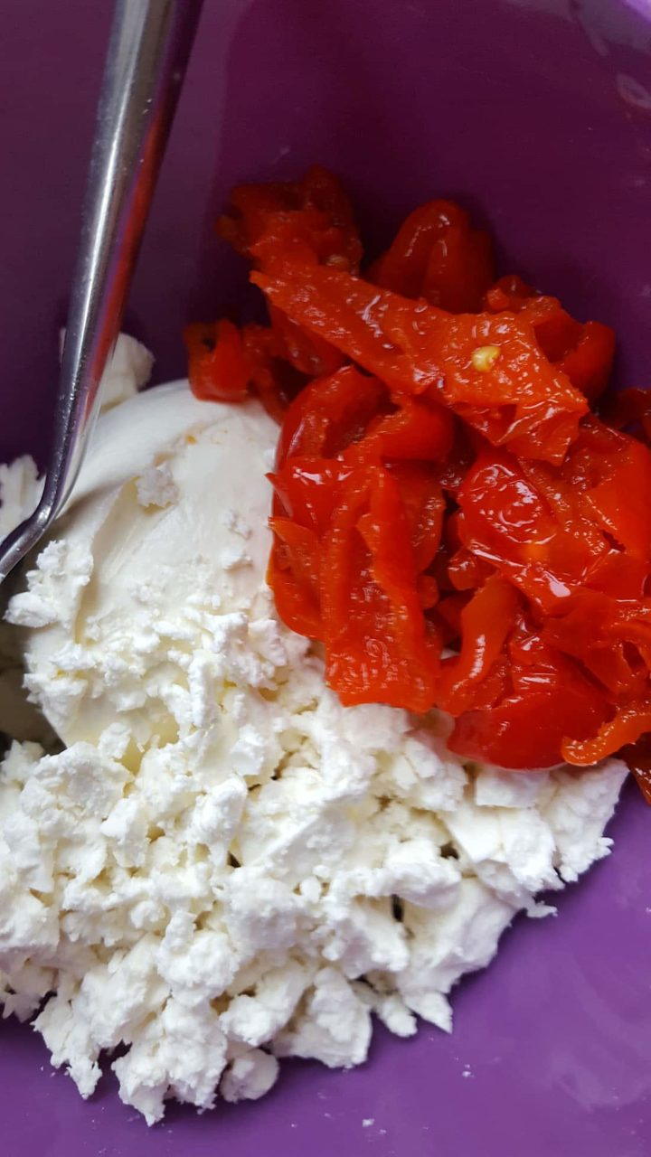 chopped peppers with feta cheese and a spoon